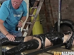 Hot gay boy lying while his entire body getting wraped in foil