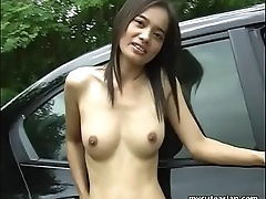 Skinny Asian brunette shows off her puss in a car