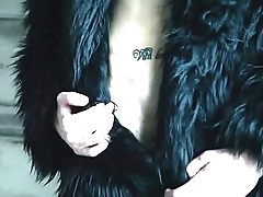 Blond twink boy nude in fur coat shows his long uncut cock