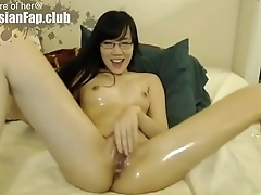 Asian Glasses babe plays with herself using glass dildos