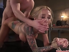 Tattooed MILF hardfucked by dominant guy