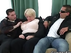 Boozed granny is picked up by two fellows