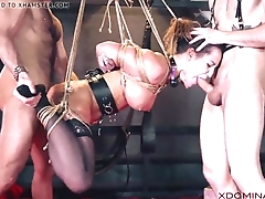 Brunette double penetrated during fetish threesome