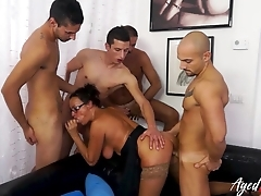 Aged brunette adores gangbang and double penetration